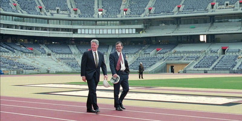 Olympic Games president Billy Payne gives former President Bill Clinton a tour of the Olympic Stadium in 1996.
