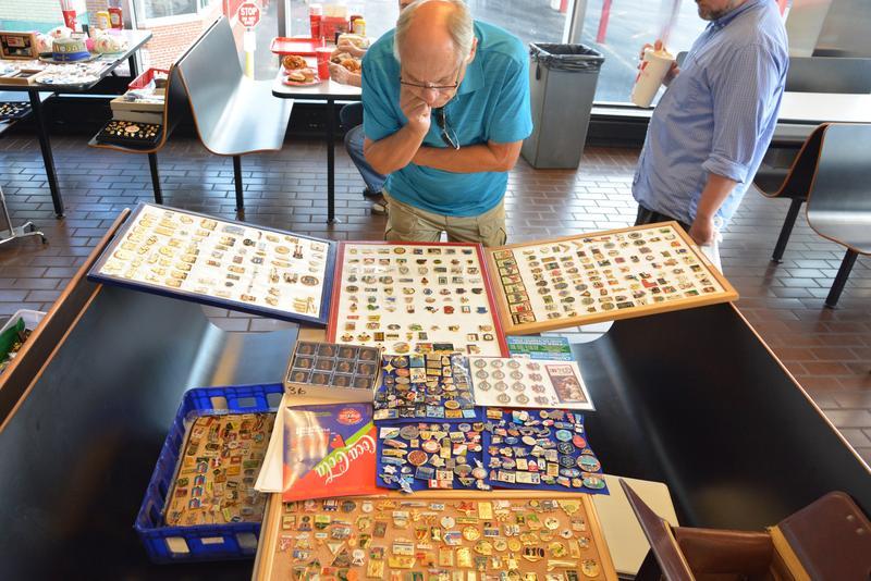Atlanta pin collectors check out the merchandise at the Varsity.