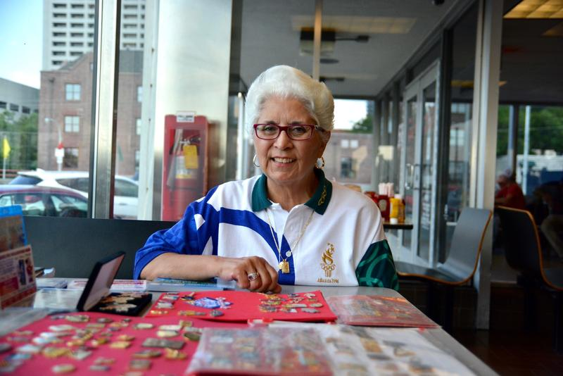 Cheryl Summers shows off part of her collection while at the Varsity pin swap in Atlanta on July 20.