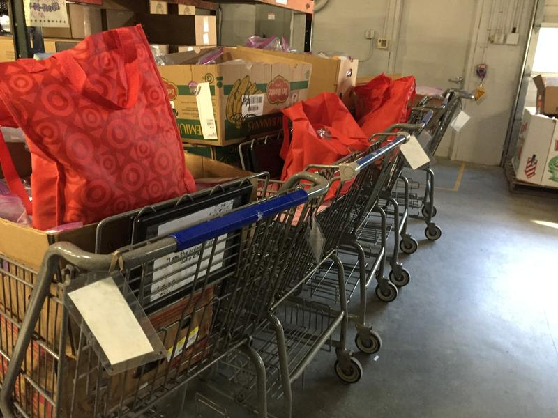 Shopping carts filled with nonperishable food items for summer lunches wait in the Co-op's warehouse.