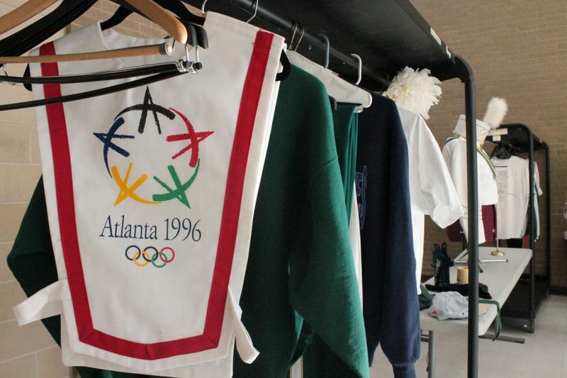 Atlanta Olympic Band uniforms hang on display at the 20-year reunion.