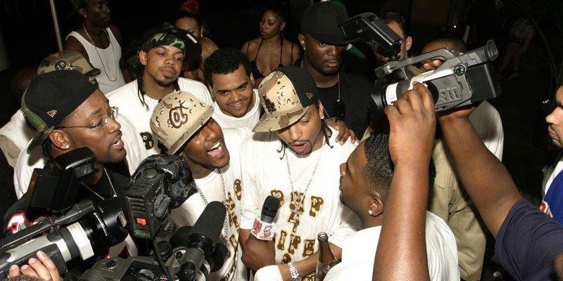 Demetrius ''Big Meech'' Flenory (center right) and Barima ''Bleu DaVinci'' McKnight (center left) celebrate Meech's birthday in the Black Mafia Family's prime.