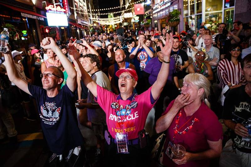Outside the RNC,  supporters celebrate as Donald Trump accepts the Republican nomination on TV.