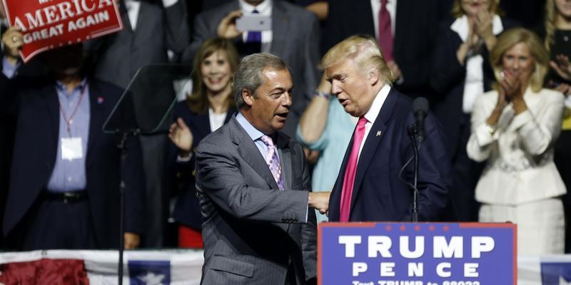Nigel Farage, ex-leader of the British UKIP party, speaks as Republican presidential candidate Donald Trump, left, listens, at Trump's campaign rally in Jackson, Miss., Wednesday, Aug. 24, 2016.