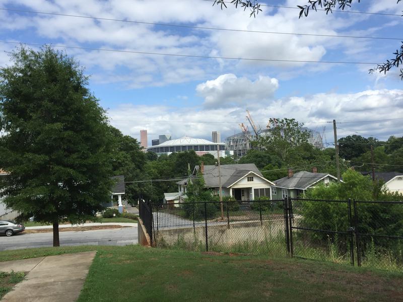 Construction cranes over the new Falcons Stadium: precursors to a changing neighborhood?