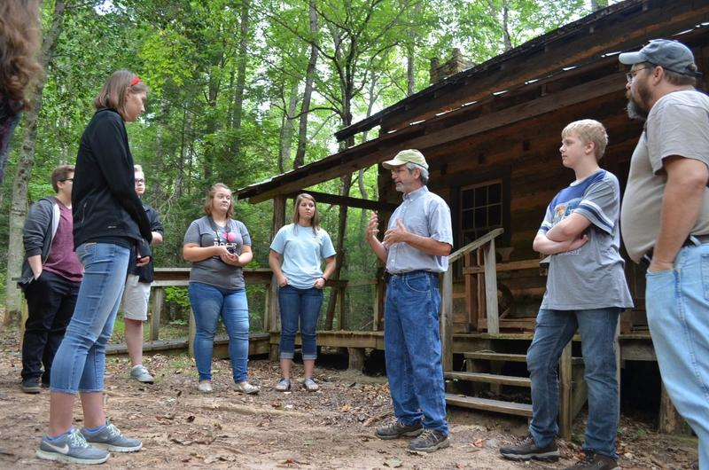 Curator Barry Stiles gives this year's magazine students a tour of the Foxfire Museum and Heritage Center in Clayton, Georgia.