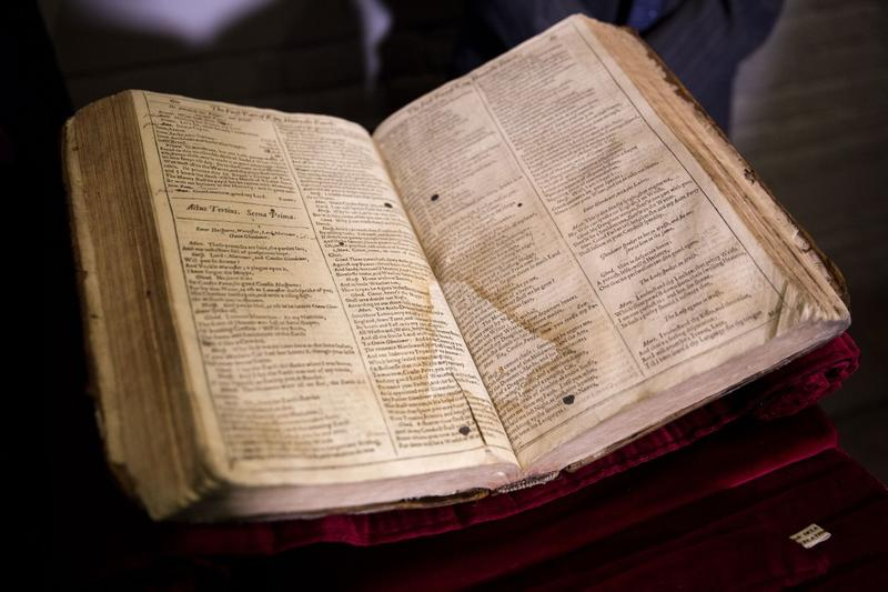 In this Feb. 23, 2015 file photo, the First Folio of Shakespeare plays is displayed after a press conference at Shakespeare's Globe theatre in London.