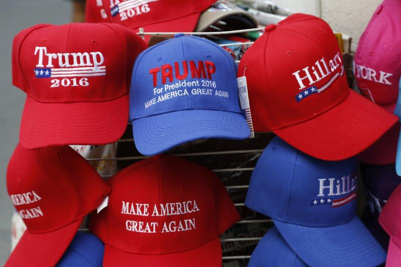 Hats displaying support for Republican presidential candidate Donald Trump and his Democratic opponent Hillary Clinton are displayed by a sidewalk vendor, Tuesday, Aug. 16, 2016, in New York.