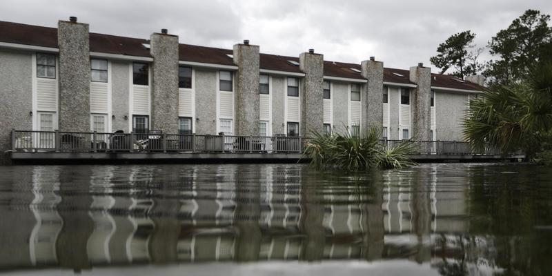 Flooding water surrounds an apartment complex after Hurricane Matthew passed through St. Simons Island, Ga., Saturday, Oct. 8, 2016.
