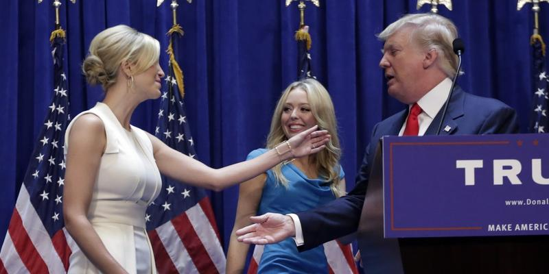 In this June 16, 2015 file photo, developer Donald Trump with daughters Ivanka Trump, left, and Tiffany Trump, after his announcement that he will seek the Republican nomination for president, Tuesday, in the lobby of Trump Tower in New York.