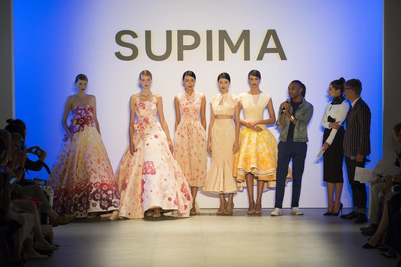 Taylor presents his designs after his runway show at New York Fashion Week.