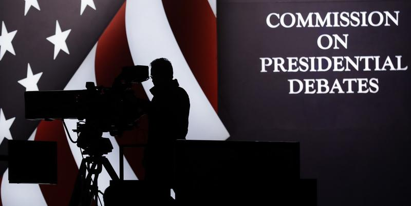 A television camera operator tests his position during a rehearsal for the third presidential debate between Republican presidential nominee Donald Trump and Democratic presidential nominee Hillary Clinton at UNLV in Las Vegas, Tuesday, Oct. 18, 2016.