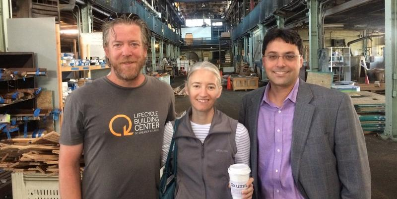 Adam Deck, director of operations for Lifecycle; Shannon Goodman, executive director of Lifecycle; and Jimmy Mitchell, a Skanska executive who is a past board chairman, stand in the historic warehouse on Murphy Street.