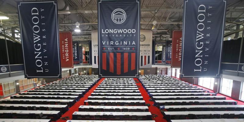 In this Sept. 7, 2016, file photo, tables are in place for the media for the Oct. 4 vice presidential debate at Longwood University in Farmville, Va.