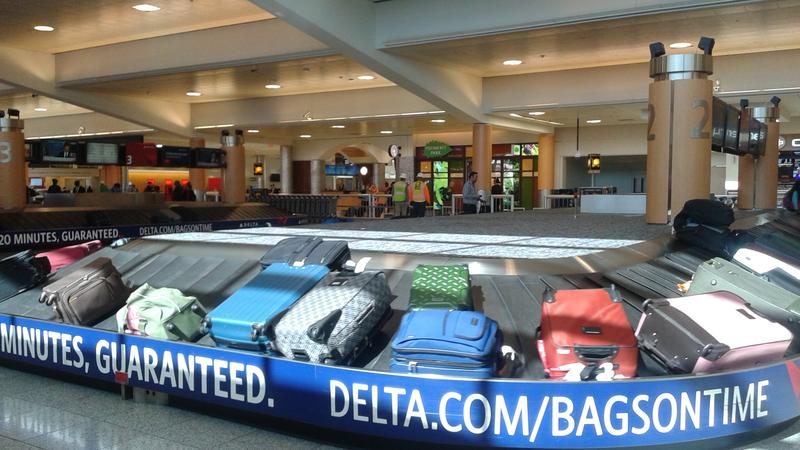 Hartsfield-Jackson Atlanta International Airport, Delta Air Lines' baggage claim area display banners saying bags are guaranteed to be delivered within 20 minutes. Delta Air Lines is the first to implement RFID luggage tags to track bags system-wide.