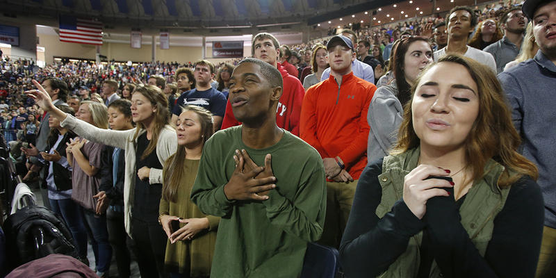 Liberty University students sing and pray prior to a speech by Republican vice presidential candidate, Indiana Gov. Mike Pence.