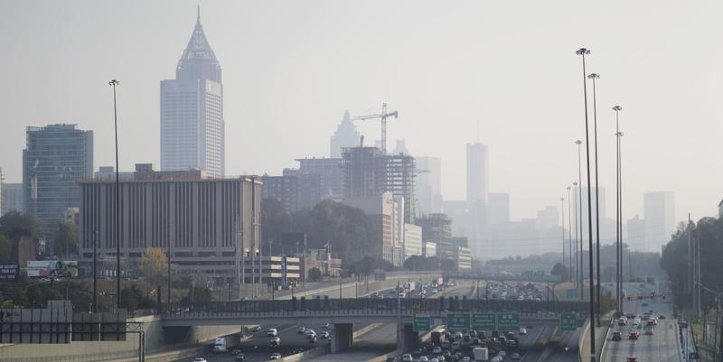 A haze hovers over the downtown skyline from a wildfire burning in the northwest part of the state, Monday, Nov. 14, 2016, in Atlanta.