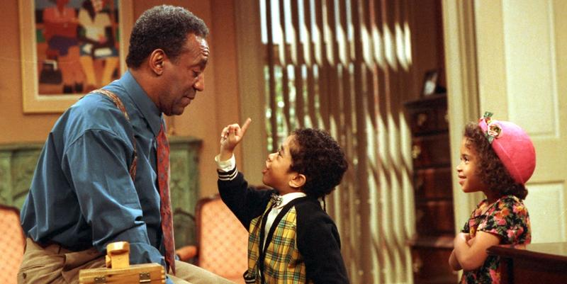 "Bill Cosby, as Dr. Cliff Huxtable of ""The Cosby Show,"" listens to a point made by his grandson Gary Gray, as his granddaughter played by Jessica Vaughn looks on during taping of the final episode before a live studio audience in New York City."