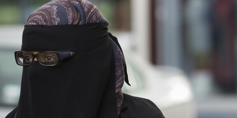 A member of the public wearing a full face veil is seen in Blackburn, England, Wednesday, Sept. 19, 2013.