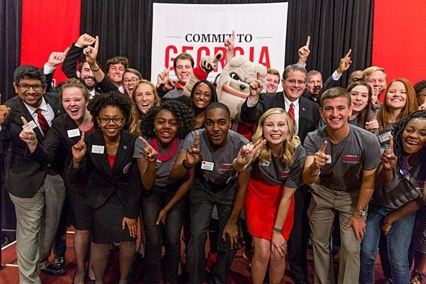 UGA President Jere Morehead (next to the Bulldog) poses with students during the school's campus kick-off event earlier in November.