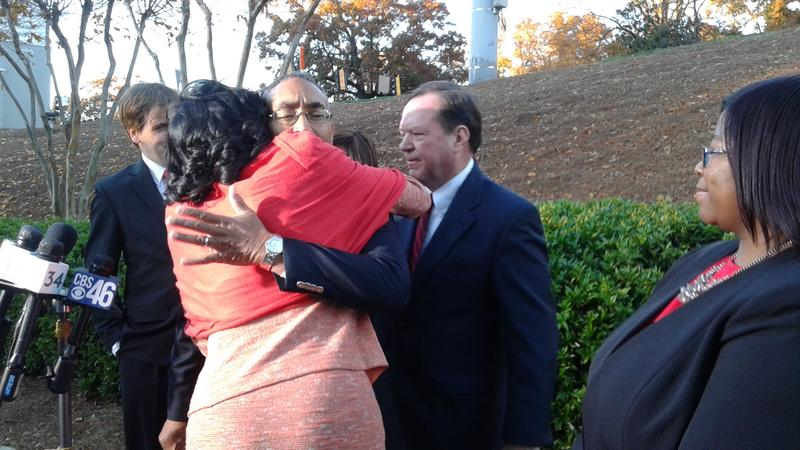 DeKalb CEO Burrell Ellis hugs his wife Philippa. He spoke out Thursday with his defense attorney Craig Gillen, for the first time since he was convicted a year and a half ago following a second trial in DeKalb County.