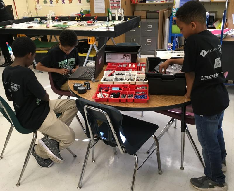 "Older students on West Manor's robotics team work on programming robots and sending them on ""missions."""