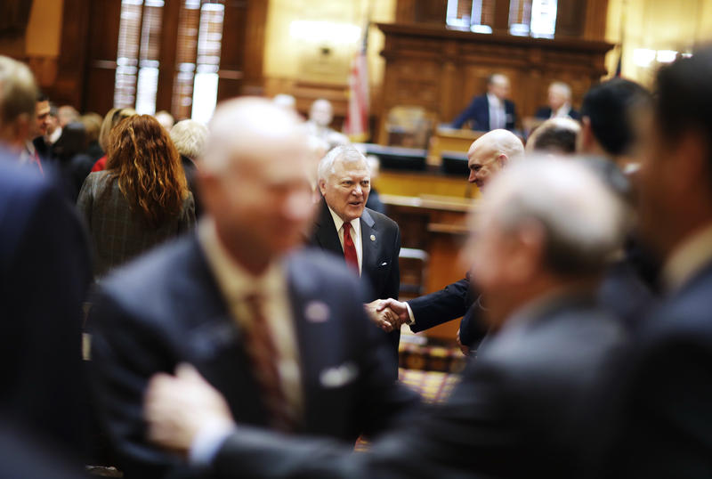 Georgia Gov. Nathan Deal shakes hands as he leaves the House floor after delivering the State of the State address in Atlanta, Wednesday, Jan. 11, 2017.