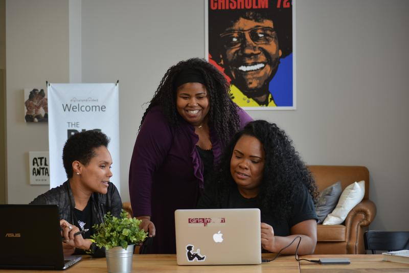 Christina Marshall-Valdez, standing, is part of the first graduating class of the BIG Incubator program in Atlanta.