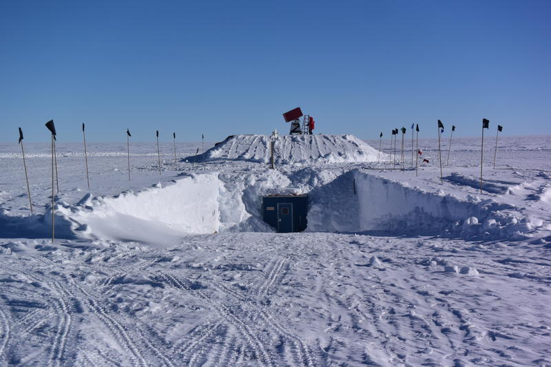 The solar observatory at the South Pole is buried under snow with instruments mounted on top.