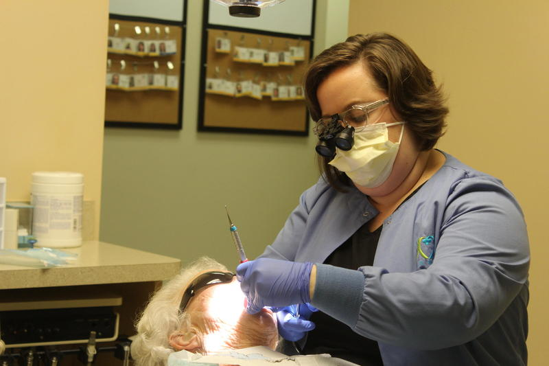 Leah Brannon cleans a patient's teeth at the Mercy Health Clinic in Athens.