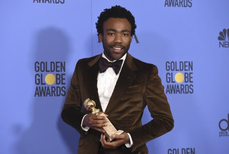 Donald Glover poses in the press room with the award for best performance by an actor in a television series - musical or comedy for