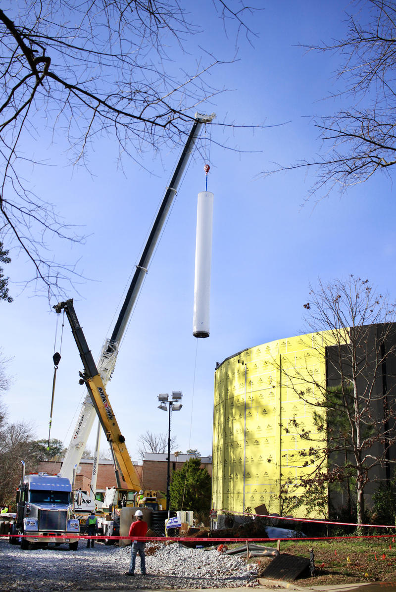 One of the spools containing part of the Cyclorama is hoisted by a crane in order to be lowered in to the History Center.