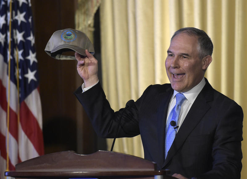 Newly appointed Environmental Protection Agency Administrator Scott Pruitt holds up a hat presented to him before speaking to EPA employees in Washington, Tuesday, Feb. 21, 2017.