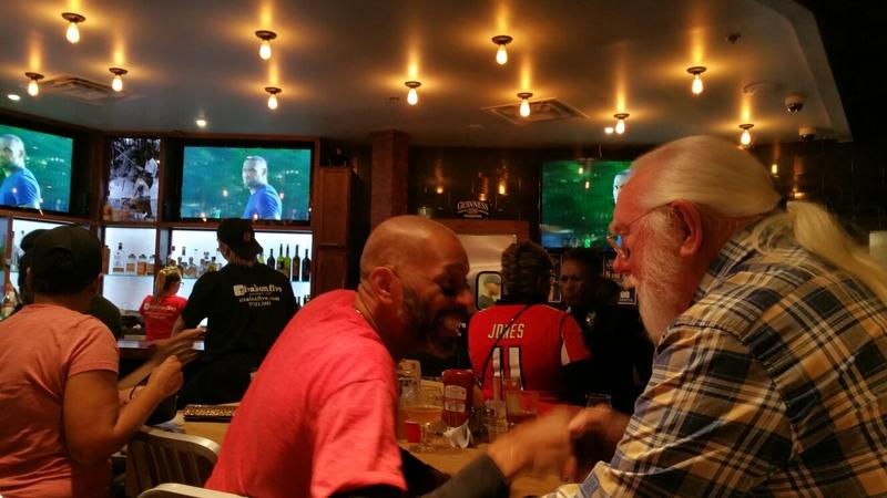 Falcons fan Bilal Zahir (in red) led chants with Doug throughout the game on Sunday night.