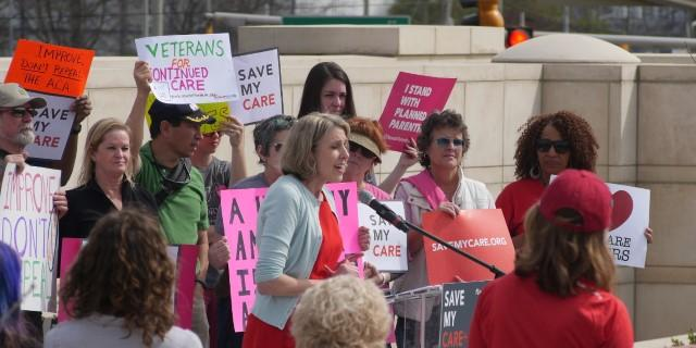 Cindy Zeldin, who leads the group Georgians for A Healthy Future, speaks at the ''Save My Care'' event at Liberty Plaza in Atlanta on Feb. 20, 2017.