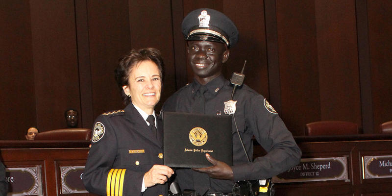 Officer Jacob Mach stands with Chief Erika Shields at the swearing in ceremony on Tuesday.
