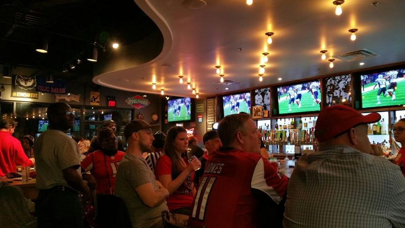 At the Rivals on Five sports bar in Stone Mountain, fans were loud and pumped during the first three quarters of the game but grew quiet when the New England Patriots made their historic comeback at the end of the game.