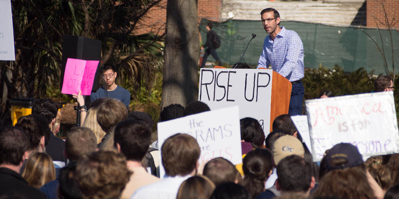 A crowd of more than 600 listened to speakers at the Georgia Tech Campanile Thursday who spoke out against President Trump's recent ban on immigration from seven countries.