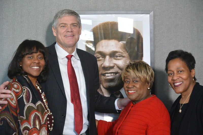 Public Broadcasting Atlanta CEO Wonya Lucas (left), Bill Lucas's wife Rubye (center right) and Daughter Andrea Lucas (right) pose with Braves alumnus Dale Murphy in front of a picture of Bill Lucas.