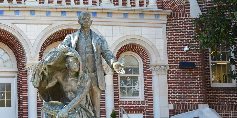 ''Booker T. Washington Lifting the Veil of Ignorance'' stands in front of Booker T. Washington High School in Atlanta.