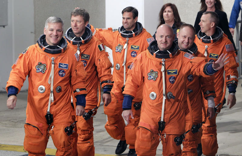 Mark Kelly, front right, is seen with the crew of space shuttle Endeavour in 2011. Kelly was in Atlanta Tuesday to kick off the Atlanta Science Festival.