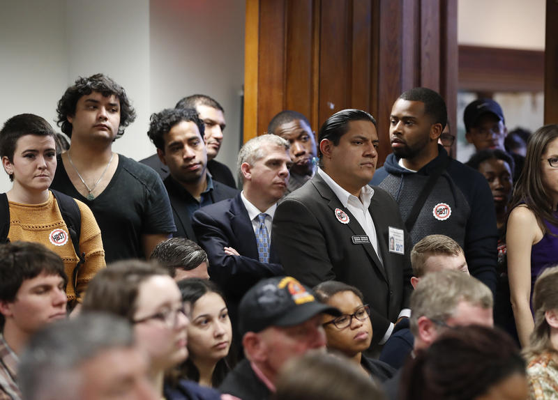 An overflow crowd gathers to hear discussion about a bill that would penalize colleges that protect undocumented immigrants, during a meeting of the House Committee on Higher Education last month in Atlanta.