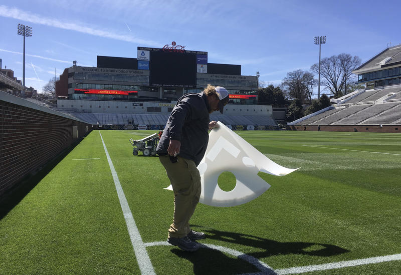 A worker paints the field at Bobby Dodd Stadium in Atlanta on Thursday, March 2, 2017, before Atlanta United's first soccer game Sunday.
