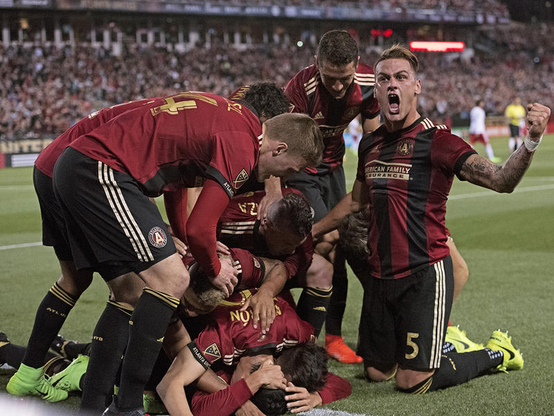 The team celebrates after Yamil Asad scored the first goal in Atlanta United history