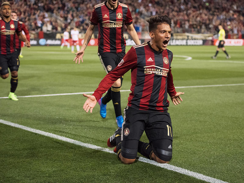 Yamil Asad falls to his knees after scoring the first goal in Atlanta United history