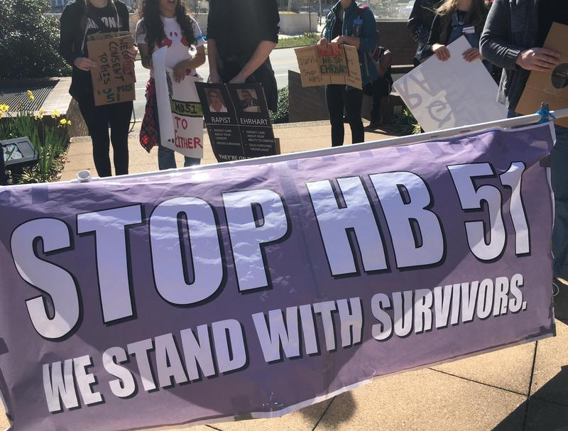 College students marched to protest House Bill 51, which would require colleges to report crimes, including sexual assaults, to police.