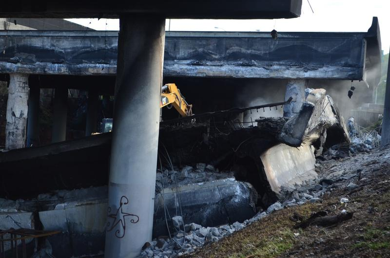 Crews were assession damage to the I-85 overpass that collapsed Thursday.