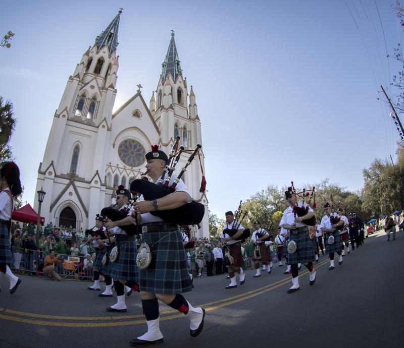 In 2015, members of the Dublin Fire Brigade Pipe Band perform while marching past the Cathedral of St. John the Baptist during the St. Patrick's Day parade. Before they watch the parade, roughly 1,000 Catholic faithful fill the church's pews.