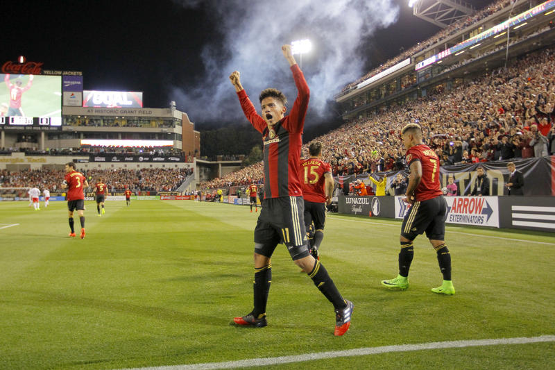Atlanta United midfielder Yamil Asad (11) reacts after scoring a goal in the first half of an MLS game against the New York Red Bulls on Sunday in Atlanta.