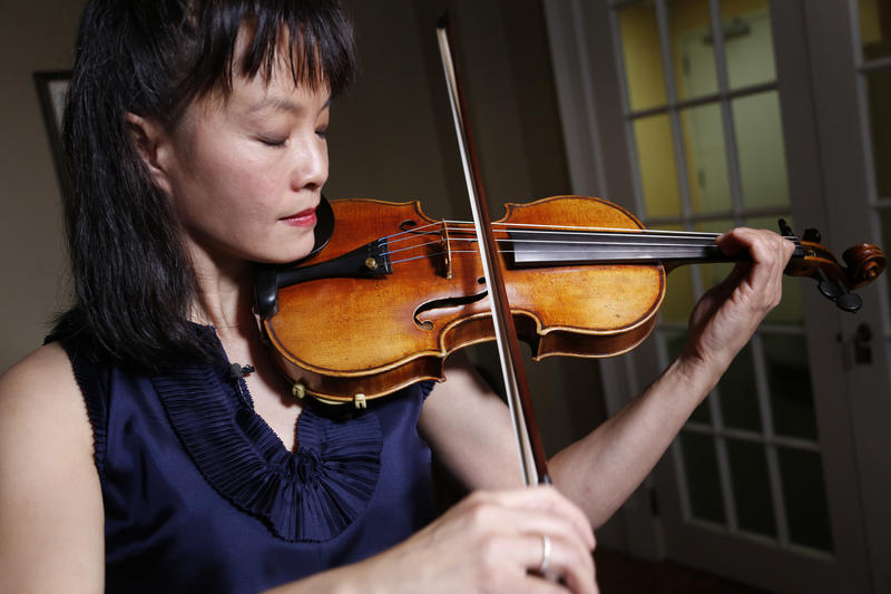 Mira Wang plays the Ames Stradivarius violin in New York on Wednesday. After a meticulous restoration that took more than a year, the Ames Stradivarius violin that was stolen from violinist Roman Totenberg is about to return to the stage.